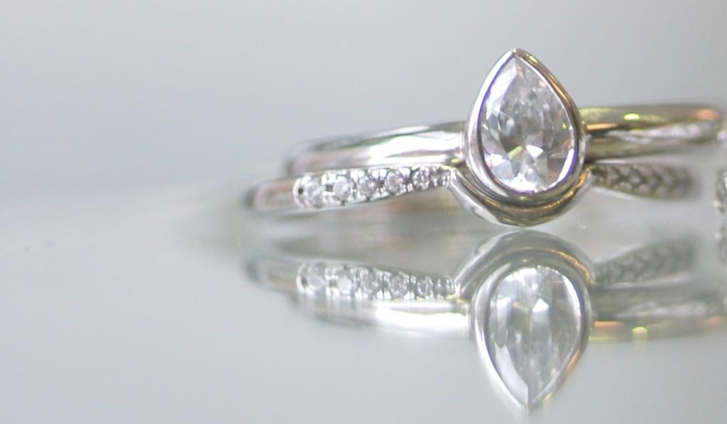 custom shaped wedding ring  pear cut engagement ring