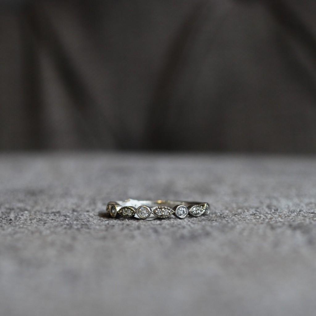 Vintage wedding ring with diamond set and millgrain detail
