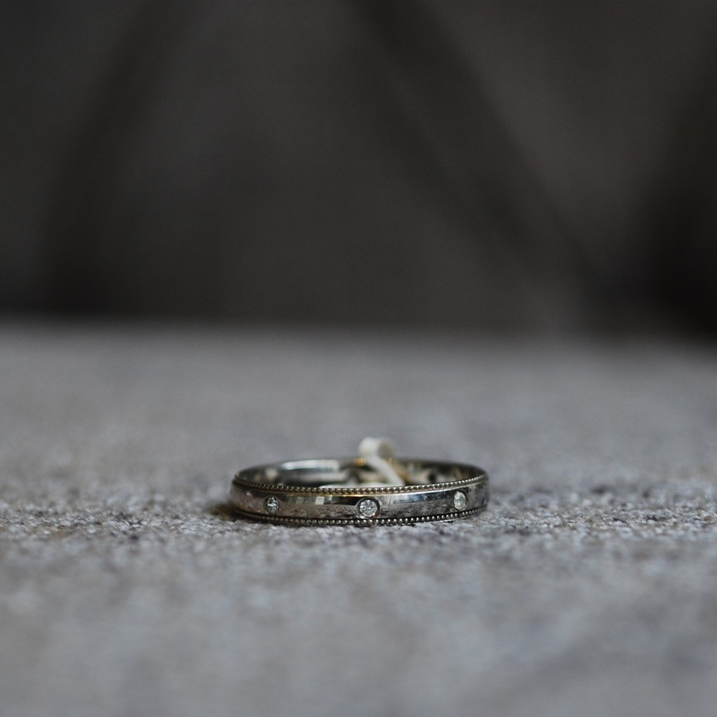 Vintage diamond wedding ring with mill-grain edge